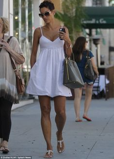 Nicole Murphy shows off her voluptuous cleavage in revealing white summer dress Nicole Murphy, Sexy Outfits, Summer Outfits, Cute Outfits, Fashion Outfits, Summer Dresses, White Dress Summer, Summer Wear, White Sundress