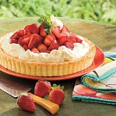 Baking the shortcake in a tart pan produces a sweet-and-sturdy base for the berries and whipped cream.