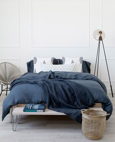 Stop your scroll 👀 and take a look at this gorgeous bed. The Spring Suzanne Dimma x Au Lit Collection is filled with unique textures, modern prints, and a refreshing colour palette. Luxury Bath, Luxury Shop, Between The Sheets, Navy Bedding, One Bed, Fine Linens, Modern Prints, Lounge Wear, Comforters