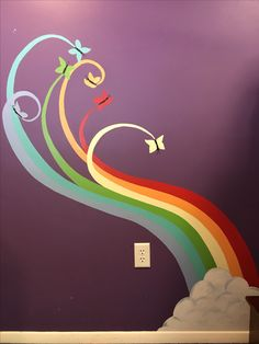 Painted this on our girls wall. Unless all latex paints we had from other rooms. Took a lot of time but they love it! I recommend using a small (1-2 in) angled brush for acrylics or oil paint. #ranibowsand butterflies #rainbows # butterflies