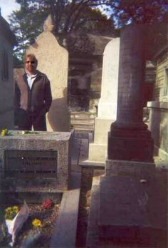 Tom Petty snapped this picture of Jim Morrison's grave site, which shows his image in the background. Considered an authentic ghost photo (Pere Lachaise Paris)
