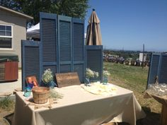 Rustic country wedding entry table with shutters, burlap table cloth and mason jar with babys breath