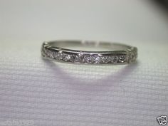 ANTIQUE ART DECO DIAMOND WEDDING BAND RING RHET-147  {International Buyers Are Responsible For Customs & Duty Fees}  CIRCA ~ 1930'S  10 ROUND SINGLE  CUT DIAMONDS ~ .15 CARAT TOTAL WEIGHT  COLOR ~ F - G  CLARITY ~ SI 1 - SI 2  MEASUREMENTS OF DIAMONDS ~ 1.55 MM x 1.55 MM x 1.00 MM  METAL ~ PLATINUM  WEIGHT ~ 1.9  GRAMS  FINGER SIZE ~ 5.75  (SIZABLE) U.S.A & CANADA (Inquire About Sizing Cost)  (L) UNITED KINGDOM, IRELAND, AUSTRALIA & NEW ZEALAND