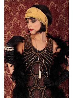 Black and gold beaded Flapper Dress with 20s style accessories. Great look for Gatsby parties