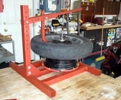 Motorcycle Tire Changer - Homemade motorcycle tire changer fabricated from 2x2 and 1x1 steel tube, nuts, and bolts.