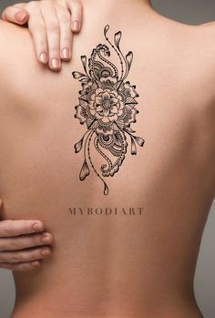 Boho Mandala Flower Back Tattoo Ideas for Women Black Floral Tribal Linework Spine Tat - ideas bohemias de la parte posterior del tatuaje de la flor - www.MyBodiArt.com #tattoos Tatoo Floral, Floral Back Tattoos, Flower Tattoo Back, Feather Tattoos, Ribbon Tattoos, Mandala Tattoo Design, Mandala Arm Tattoo, Geometric Mandala Tattoo, Mandala Flower Tattoos