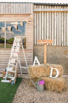 Hay bales | Giant Letters | Step Ladder - Photography by Cat Lane Weddings | Lace Justin Alexander Wedding Dress | Outdoor Wedding at Furtho Manor Farm | Peach Flowers | Monsoon Bridesmaid Dresses