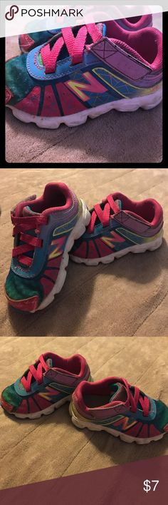 New balance size 5.5 tennis shoes My daughter loved these. Multiple colors so will go with everything. Velcro straps. Do shoe a little signs of wear but lots of life left Shoes Sneakers