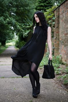 Fashion blogger Stephanie of FAIIINT wearing Glamorous dipped hem dress, Belle's Bejewelled diamond geometric necklace, skin by Finsk cut out wedges, Bracher Emden classic tote bag. All black outfit, street style, goth.