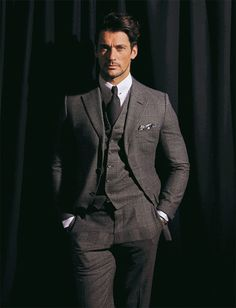 A business suit with a twist – simple shades of grey with a crisp white shirt and collar bar.