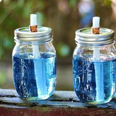 Mason jar tiki torches  Take along while camping or use in your back yard to repell those pesky mosquitos. They also look very cute and are easy to clean if the top smokes up. Love this idea!