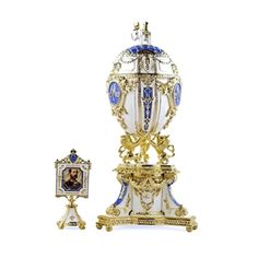 History: Russian Imperial Royal Danish Jubilee Egg is surmounted by a Danish Royal Elephant and supported by 3 danish heraldic lions, the white enameled egg is marked by diamond-set imperial crown. At the center it has the crowned monogram of Tsarina Mariya name, emblazoned in rose-cut crystals. The double-sided miniature photo frame surmounted by a crystal crown is fitted inside. The egg was gifted by Russian czar Nicholas to his wife Mariya Fyodorovna in 1903. It's missing nowadays