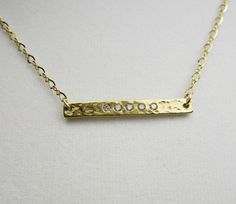 CZ Horizontal Gold Bar Necklace by TurtleCoveDesigns.  Fabulous horizontal 18kt gold vermeil bar necklace, hammered and inlaid with CZ stones. A standout piece completed with a sparkling 14kt gold filled figure 8 chain. A lovely finishing touch for any ensemble.