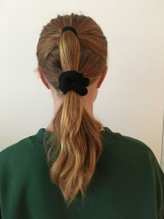 Double tail. 1. Put a pony tail in the upper hair section, let the rest of the hair lay normal down. 2. Add all of your hair to a lower tail.  Voila - Nice and easy!
