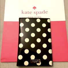 NWT Kate Spade Passport holder NWT Kate Spade passport wallet! Can function easily as a small wallet since the red interior has 6 credit card slots! Measures approx 4x4x5.25. ⛔️No Trades Please!⛔️ kate spade Bags Wallets
