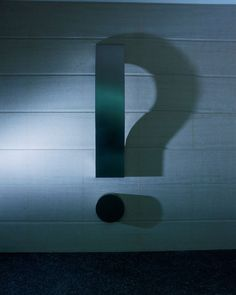 A giant steel exclamation point, lit from right angle becomes a question mark (Designer: Kumi Yamashita)