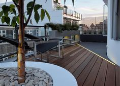 Roof terrace with hardwood balau decking and black granite, separated by LED strip lighting // Amir Schlezinger