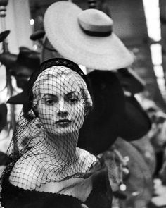 Miss Sweden, Anita Ekberg, sporting a veiled hat by Mr. John during a hat-buying spree while visiting the US for work as a model. She would go on to star in many films including Federico Fellini's La Dolce Vita. She was born today, September 29, 1931. (Lisa Larsen—The LIFE Picture Collection/Getty Images) #LIFElegends