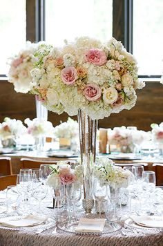 Blooms in varying shades of cream, peach and pink create an incredibly romantic centerpiece.