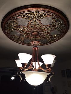 Painted Filigree Medallion from www.plastergallery.com. Fabulous paint job and fabulous light fixture pairing.