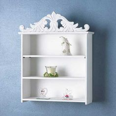 Victorian style white wood unit with curvy carved crown has three spacious shelves