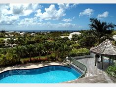"""Island Villas - Barbados - Palm Ridge Royal Westmoreland """"Seventh Heaven""""   Sale Price: USD $3,400,000.00     Bedrooms: 5  Bathrooms: 5 (1 Half)  Pool: YES  Beautifully furnished and decorated, this villa also features a spectacular Trompe L'oiel painting and is surrounded by lush tropical gardens making Seventh Heaven a villa which truly lives up to its name."""