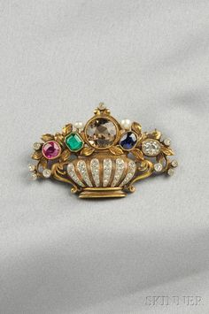 Gem-set Flower Basket Brooch, F. Walter Lawrence, set with emerald-cut emerald, cushion-cut ruby and sapphire, and old cushion-cut diamond and old mine-cut diamond accents, lg. 1 7/8 in., signed F.W.L.