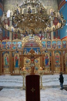 St. Joseph the Betrothed Ukrainian Greek-Catholic Church in Chicago, IL. This chandelier is called a polyeleos, meaning much oil, and the circle of icons around it is called a horos/choros, meaning dance.  In Byzantine Churches, this chandelier is traditionally swung during the polyeleos prayers as a sign of joy, though the practice is rarely seen outside monasteries.     http://www.stjosephukr.com/ #UGCC #Iconostas #Chandelier #Church