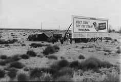 Moving away from areas hit particularly hard by the Depression such as Oklahoma, people lived in their cars, often camping behind billboards.