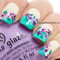 Nail Art – Flowers by mynailpolishonline. Used: My Vampire is Buff, China Glaze – Too Yacht To Handle at the tips. The flowers are done using two colors, China Glaze – Lotus Begin and Kicks – Spring Lilac.
