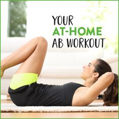 Woman lying on back in living room doing ab exercises