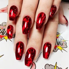 Blood Thirsty Blood Thirsty INSTAGRAM This blood red nail effect is perfect if you're stepping out with the classic vampire costume this Halloween or if you're just a huge Twilight fan (no judgement). Start with a foil base and then add a red glass gel for the vile effect.