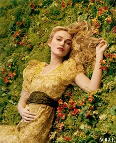 Keira Knightley in a Vera Wang gold flower-decked dress. Photo: Annie Leibovitz…