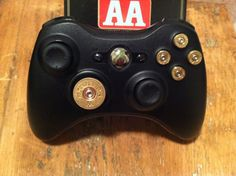 Xbox 9mm Shotgun Shell bullet button Controller Video Game gun brass shells handmade handcrafted video games call of duty gears of war. $67.89, via Etsy.
