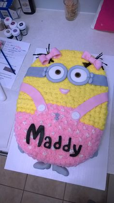 Girl minion (based off birthday girl's shirt), vanilla cake with white chocolate mousse filling, buttercream star-tip decorated