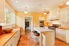 Hmmm: they have the same color tile and countertop. I wouldn't have considered this peachy color, but it looks good