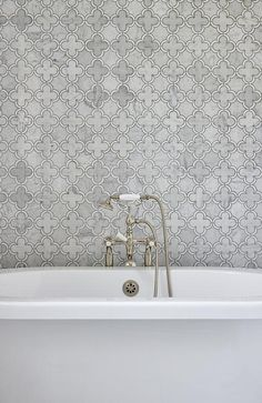 White roll-top freestanding tub in a walk in shower displaying gray marble quatrefoil accent tiles and a vintage handheld shower kit. Gray And White Bathroom, Grey Bathroom Tiles, Grey Bathrooms, Beautiful Bathrooms, Small Bathroom, Bathroom Ideas, Master Bathroom, Tub Tile, Bathroom Closet