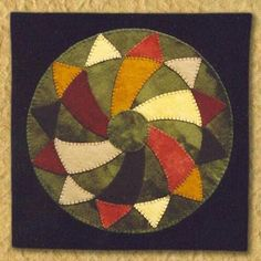 this is a picture of the first penny rug I sewed