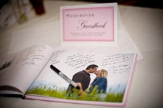 love this idea of using a book of engagement photos as a guest book