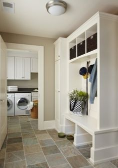 Like this mudroom cubby with a cupboard on the one end to put some of the things you want hidden away.