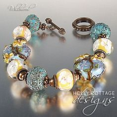 Lampwork and copper bracelet from hollycottagedesigns on Ruby Lane