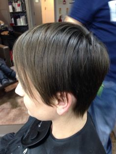 After photo of a haircut, a short graduation with a long fringe