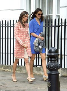 Pippa was seen heading to the church with an equally chic pal