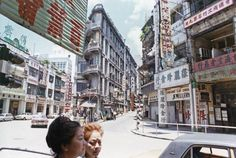 Queens road central at western end where Wellington street meets it.1960's HK