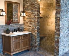Rustic Bathroom Showers walk through shower behind the wall containing the fireplace