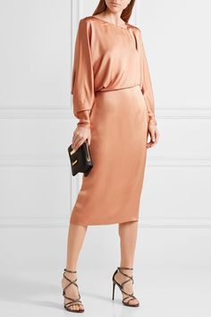 TOM FORD Draped cutout silk-satin midi dress $3,450 TOM FORD's dress has been crafted in Italy from lustrous silk-satin. Cut to drape loosely across the bodice, this tan style has a fitted midi skirt and contemporary, angled neckline. The vented back ensures you can move easily when wearing it with heels.  Shown here with: TOM FORD Shoulder bag, TOM FORD Sandals, Cornelia Webb Ring.