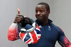 Pilot Lamin Deen of Great Britain team 1 gives a thumbs up as he finishes a run during the Men's Two-Man Bobsleigh (c) Getty Images Bobsleigh, Olympic Athletes, Two Men, Winter Olympics, Winter Sports, Great Britain, Sport Outfits, Beautiful Men, Sports