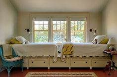 """One bedroom is meant for the kids, and it's outfitted with twin beds as well as these mattresses placed atop a storage platform. """"The idea i..."""