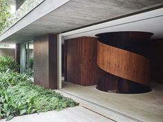 Contemporary House With A Beautiful Spiral Staircase And A Lush Garden: A rough concrete facade is not always associated with industrial buildings, warehouses and such. One project which resonates with this idea is the CM Staircase Handrail, Modern Staircase, Staircase Design, Spiral Staircases, Jardin Luxuriant, Indoor Courtyard, Concrete Facade, Patio Interior, Interior Design