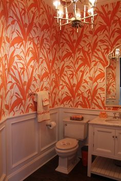 great wall paper for a half bath molding tones down the loud qualities of the wallpaper powder roomsbathroom - Designer Wallpaper For Bathrooms